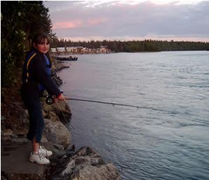 Allison fishing the world famous Kenai River for Rainbows