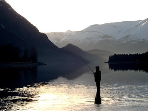 Morning silhouette on Kenai Lake at the headwaters of the Kenai River in Alaska